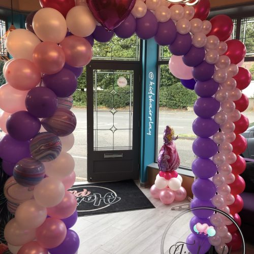 purple with and pink balloon arch