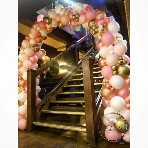 pink ivory and gold balloon arch