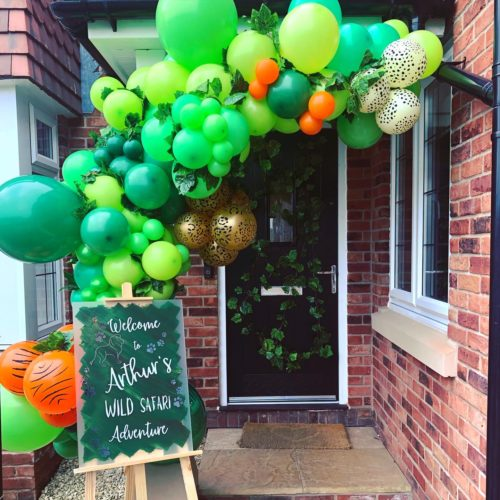 Green orange and gold balloon garland outdoor jungle theme